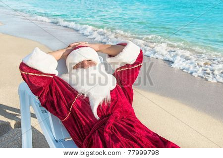 Santa Claus Have A Rest In Lounge On Sea Beach