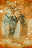 picture of blanket snow  - Festive little girls under a blanket against candle burning against festive background - JPG