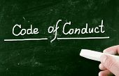 stock photo of conduction  - Code Of Conduct concept handwritten with chalk on a blackboard - JPG