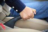 picture of seatbelt  - driver pulling the hand brake in car - JPG