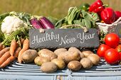 picture of farmer  - Healthy New Year against vegetables at farmers market - JPG