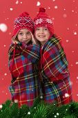 picture of blanket snow  - Festive little girls under a blanket against green fir branches with snow - JPG