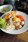 pic of gai  - Gai pad bai gaprow style Thai dish with fried egg and rice noodles - JPG