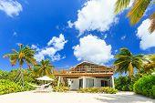stock photo of mile  - Beach house at the 7 mile beach - JPG
