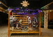 foto of nativity scene  - Christmas Nativity Scene with Three Wise Men Presenting Gifts to Baby Jesus - JPG