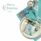 stock photo of merry christmas text  - Modern Christmas table place settings in aqua blue silver and white theme with Merry Christmas sample text and copy space for your text here - JPG