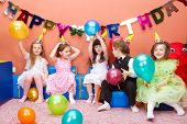 stock photo of birthday party  - Group of preschool kids at the birthday party - JPG