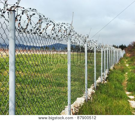 Fence with barbed wire.