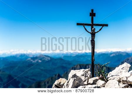 Small Iron Crucifix On Top Of A Mountain