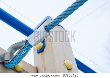 A Detailed Closeup Macro Of A Rope Mooring Line Fastened To A Cleat.