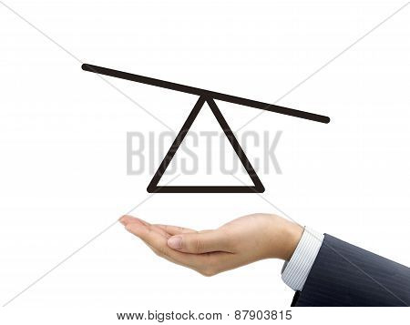 Seesaw Diagram Holding By Businessman's Hand