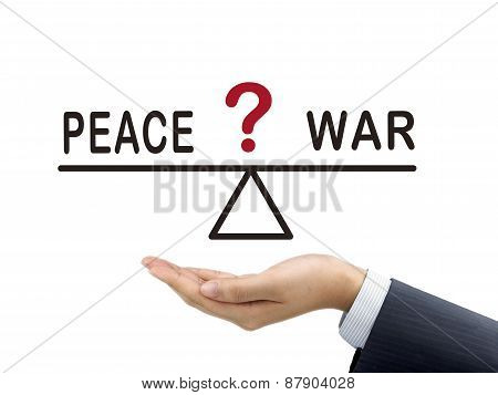Balance Between Peace And War Holding By Businessman's Hand