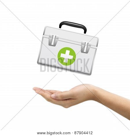 Businessman's Hand Holding First Aid Kit