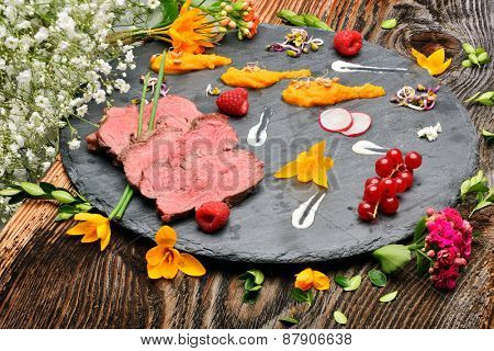slices of duck fried meat in fancy food arrangement