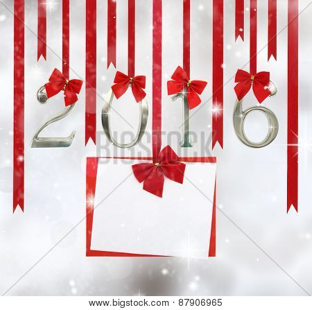 2016 number ornaments and greeting card hanging on red ribbons
