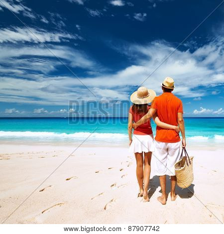 Couple relaxing on a tropical beach Anse Intendance at Seychelles, Mahe.