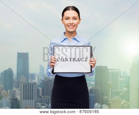 business, people, employment and law concept - young smiling businesswoman holding clipboard and contract over city background