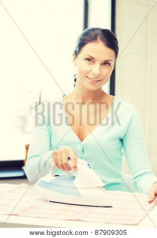 bright picture of lovely housewife ironing clothes
