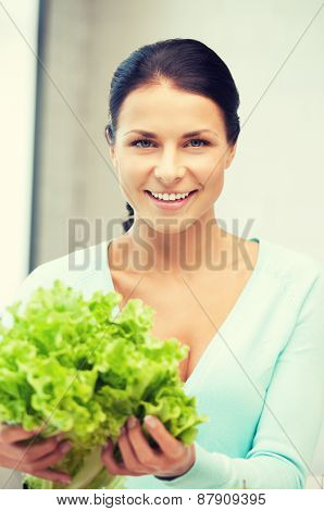 picture of beautiful woman in the kitchen.