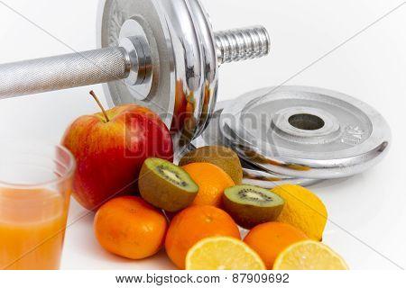 Fitness Equipment And Healthy Food, Apple, Nectarines, Kiwi, Lemon, Juice, Dumbbells  And Measuring