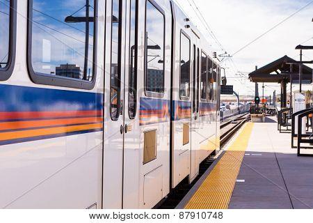 public train on Railroad station in Lone Tree Colorado.