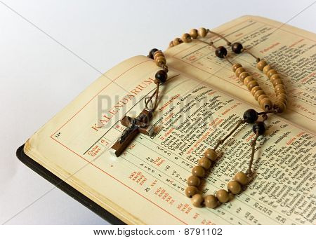 Rosary beads and breviary