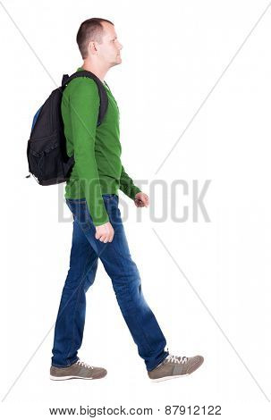 back view walking  man with backpack. brunette guy in motion. backside view person.  Rear view people collection. Isolated over white background. young man goes to side of a rolling travel bag
