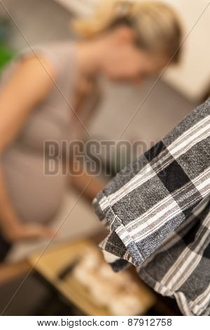A Kitchen Towel In Front Of A Pregnant Woman