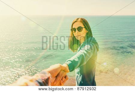 Couple In Love Resting On Coastline Near The Sea