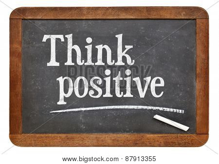 Think positive - inspirational words on a vintage slate blackboard