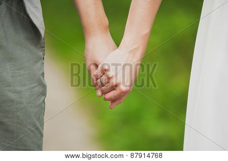 Man And Woman Holding Hands. Young Couple In Love Standing Together
