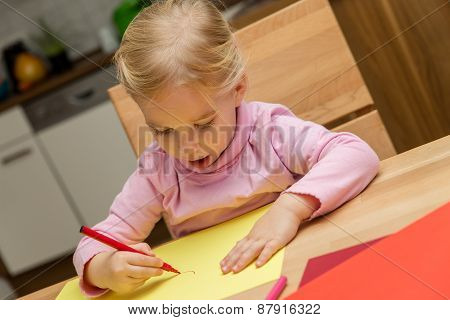 Cute Little Girl Is Painting A Picture