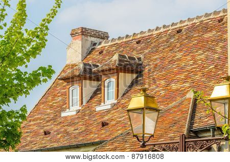 Nice mediterranean house facades roofs and windows with different colours