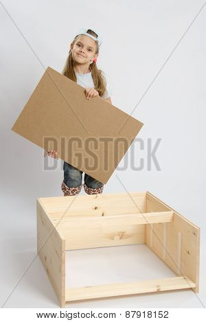 Child Carpenter Collects Dresser