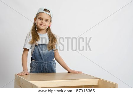 Portrait Of A Child In Working Clothes Carpenter