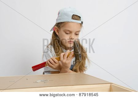 Girl Holding A Hammer Wrong