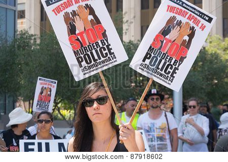 Woman Holding Two Signs