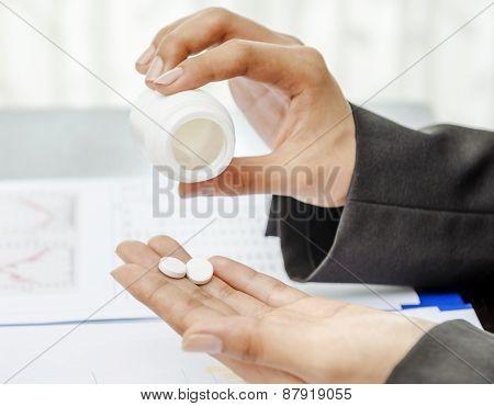 Closeup of hand holding medicine