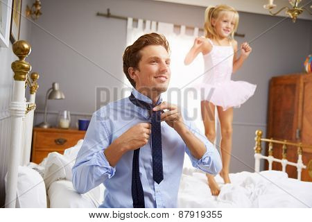 Father Dresses For Work As Daughter Plays In Bedroom
