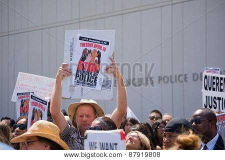 People Raising Signs In Front Of Los Angeles Police Department