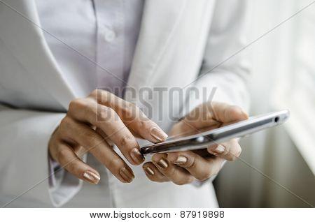 Macro of woman hand on phone