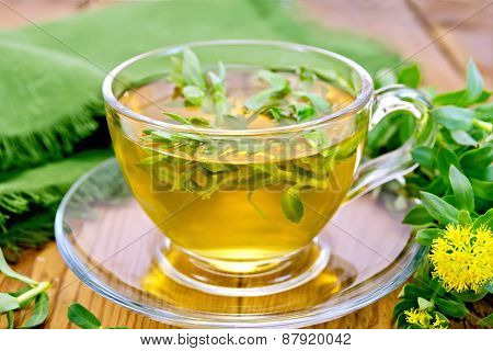 Herbal tea with Rhodiola rosea and napkin on board