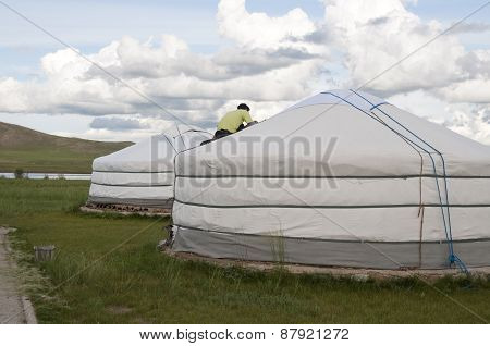 Man Sheltering With Needle And Thread A Yurt