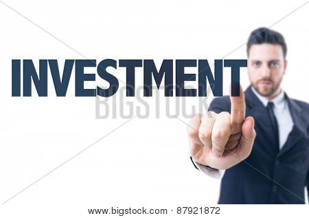 Business man pointing the text: Investment