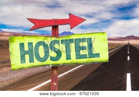Hostel sign with road background