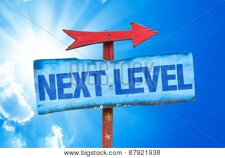 Next Level sign with sky background
