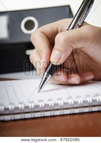 Holding ballpoint pen