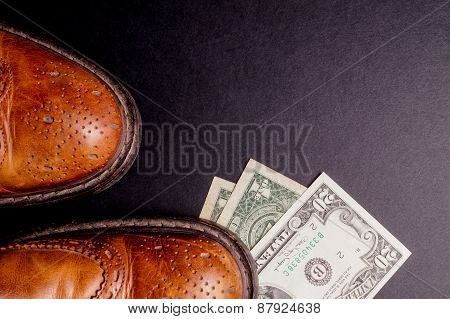 Dollars Under A Pair Of Shoes