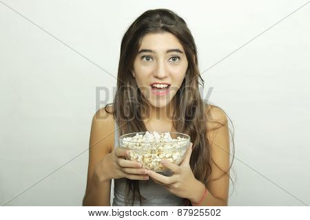 Young woman watching a movie.