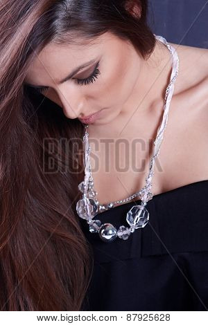 Girl Wearing A Necklace